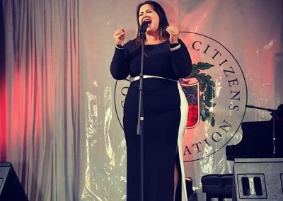 Deanna singing her heart out on stage at the 70th annual NYC Columbus Day Parade.